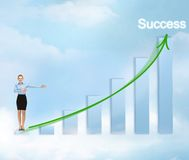 Businesswoman with big 3d chart Stock Photos