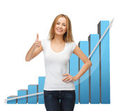 Businesswoman with big 3d chart Stock Photo