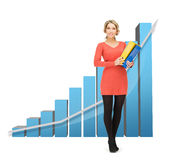 Businesswoman with big 3d chart and folders Stock Photo