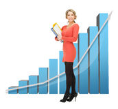 Businesswoman with big 3d chart and folders Stock Photography