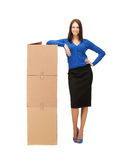Businesswoman with big carton boxes Royalty Free Stock Photography
