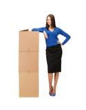 Businesswoman with big carton boxes Stock Photo