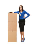 Businesswoman with big carton boxes Royalty Free Stock Image