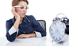 Businesswoman with a big clock Stock Photos