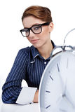 Businesswoman with a big clock Stock Image