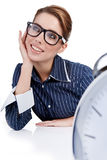 Businesswoman with a big clock Royalty Free Stock Image
