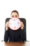 Businesswoman with big clock at the office Royalty Free Stock Photos