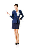 Businesswoman with big conceptual car keys Royalty Free Stock Photo