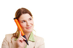 Businesswoman with big pen Royalty Free Stock Photography