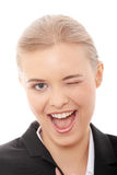 Businesswoman with big smile blinking Stock Photography