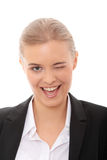 Businesswoman with big smile blinking Royalty Free Stock Photo
