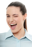 Businesswoman with big smile blinking Royalty Free Stock Photos