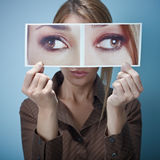 Businesswoman with big squint-eyes Stock Image
