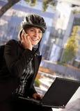 Businesswoman in bike helmet Stock Images