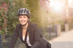 Businesswoman Biking at the Street with Helmet Stock Images