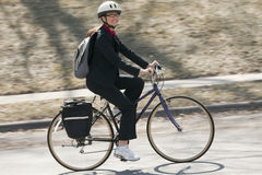 Businesswoman Biking to work Royalty Free Stock Image
