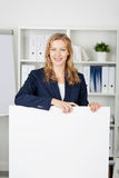 Businesswoman With Billboard In Office Stock Photos