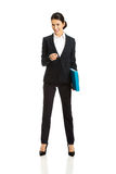 Businesswoman with binder pointing on you Stock Photo
