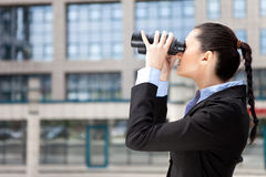 Businesswoman with binocular Stock Photography