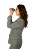 Businesswoman with binocular Royalty Free Stock Photos