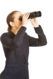 Businesswoman with a binocular Stock Image
