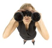 Businesswoman with binoculars. Business woman with large binoculars Royalty Free Stock Photos