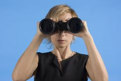 Businesswoman with binoculars. Business woman with large binoculars Stock Images