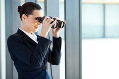 Businesswoman with binoculars Royalty Free Stock Photos