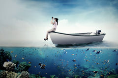 Businesswoman with binoculars on boat Royalty Free Stock Photography