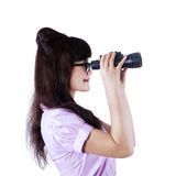 Businesswoman with binoculars isolated Royalty Free Stock Image