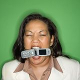 Businesswoman biting cellphone. Royalty Free Stock Photography