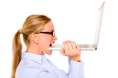 Businesswoman biting a computer Royalty Free Stock Image