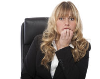 Businesswoman biting her nails in trepidation. And fear as she anticipates a problem Royalty Free Stock Photography