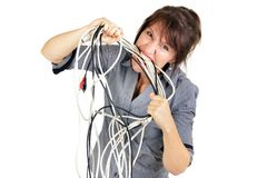 Businesswoman biting wires. Stressed business woman biting electric cables royalty free stock photo