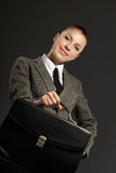 Businesswoman with black briefcase Royalty Free Stock Photos