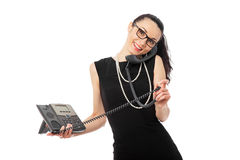 Businesswoman in black dress talking on the telephone Royalty Free Stock Image