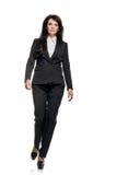 Businesswoman in black suit Stock Image