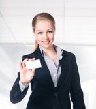 Businesswoman in black suit holding empty blank Royalty Free Stock Image