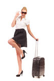 Businesswoman with Black Suitcase makes OK sign. Stock Photo