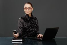 Businesswoman in black texting Royalty Free Stock Photography