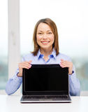 Businesswoman with blank black laptop screen Royalty Free Stock Photos