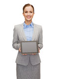 Businesswoman with blank black tablet pc screen Stock Photo