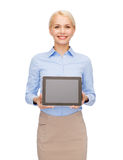 Businesswoman with blank black tablet pc screen Royalty Free Stock Image
