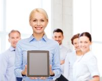 Businesswoman with blank black tablet pc screen Stock Image