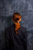 Businesswoman by blank blackboard. Businesswoman standing by blank blackboard Royalty Free Stock Image
