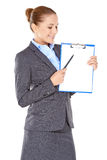 Businesswoman with a blank clipboard Royalty Free Stock Image