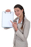 Businesswoman with a blank clipboard Stock Photo