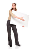 Businesswoman - blank sign handshake. Isolated studio shot of a Caucasian businesswoman holding a large blank sign and reaching out to shake hands as if she were Royalty Free Stock Image