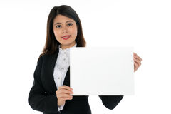 Businesswoman with Blank Sign. A Businesswoman with Blank Sign and smiling Royalty Free Stock Photo