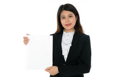 Businesswoman with Blank Sign. A Businesswoman with Blank Sign and smiling Royalty Free Stock Images